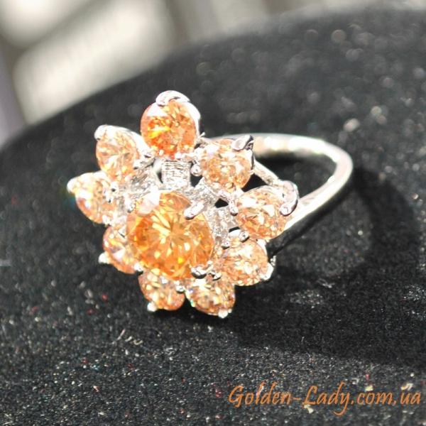 женское колечко с оранжевыми камнями цитринами