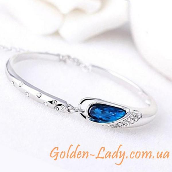 браслет с овальным синим камнем