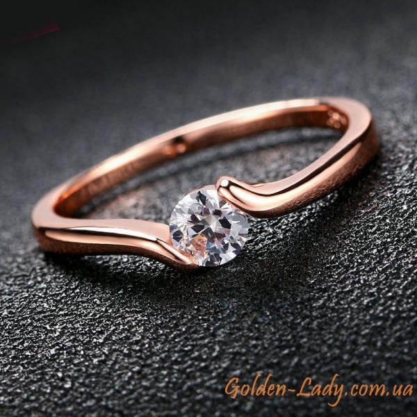 кольцо с камнем с заворотами
