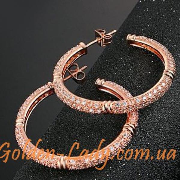 Серьги кольца гвоздики с камнями фианитами