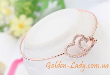 золотой браслет с двумя сердцами