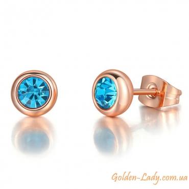 Серьги-гвоздики с голубыми камнями